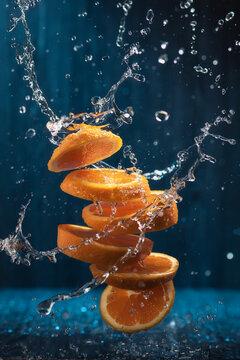 Splash Of Sliced Orange With Water Drops