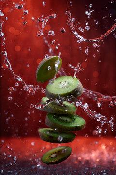 Splash Of Sliced Kiwi With Water Drops