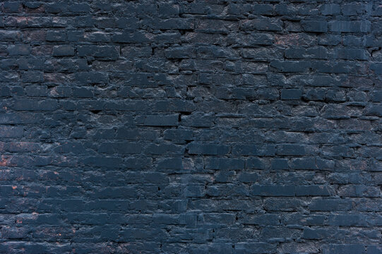 Brick wall in soot after a fire.