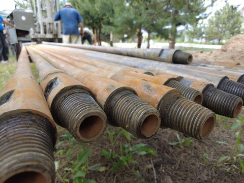 Europe, Kiev region, Ukraine - June 2021: An engineer is drilling a water well. Drilling rig worker during work. The process of drilling a well for water. Drilling rig.