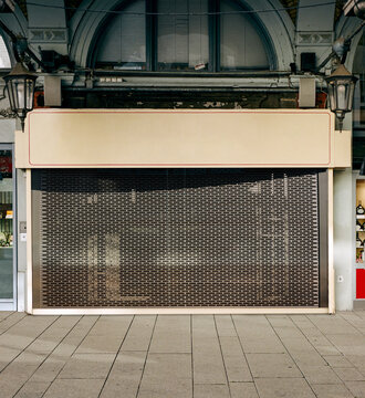 closed wine shop or alcohol store in the urban city, impact of the corona virus 2021, collapse of the retail trade.
