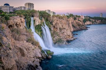 Waterfall Duden falling into the Mediterranean sea in Antalya, Turkey. Sunset in Antalya Wall mural