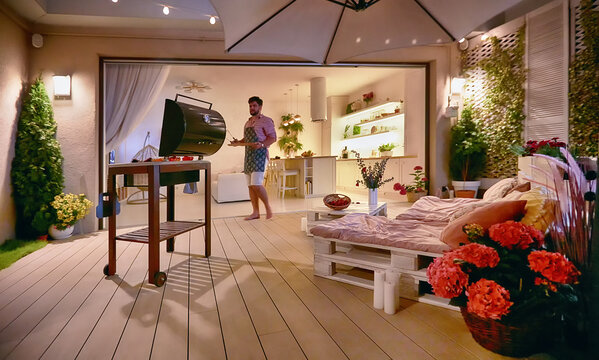 cozy rooftop patio with pallet furniture, barbecue and open space living room