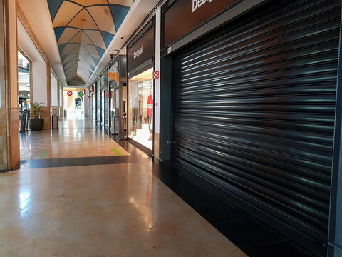 Empty Shopping center with stores closed due to COVID-19 confinement
