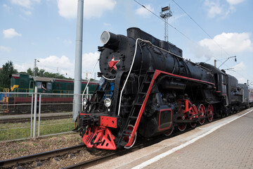 The locomotive of the last century standing under steam