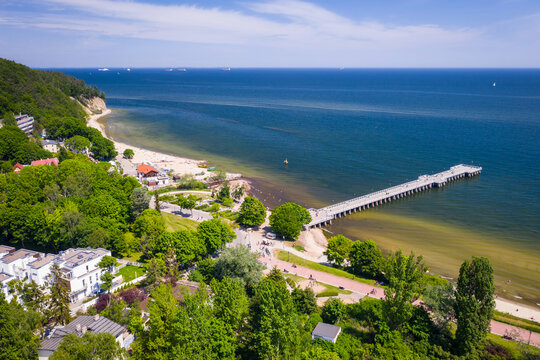 Aerial landscape of the beach and pier of the Baltic Sea in Gdynia Orłowo at summer, Poland.