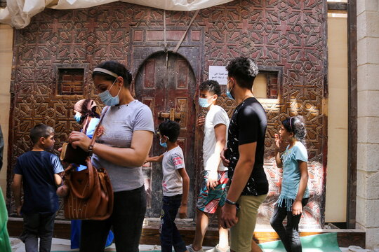 """Egyptian Christians are seen during a ritual mirroring the Holy Family's """"flight to Egypt"""" at the Monastery of the Virgin Mary on Jabal al-Tair, amid the coronavirus disease (COVID-19) pandemic in Minya Governorate"""