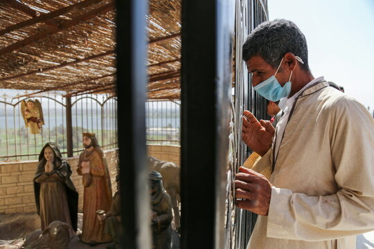 """Egyptian Christians pray during a ritual mirroring the Holy Family's """"flight to Egypt"""" at the Monastery of the Virgin Mary on Jabal al-Tair, amid the coronavirus disease (COVID-19) pandemic in Minya Governorate"""