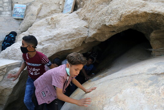 """Egyptian Christian children are seen during a ritual mirroring the Holy Family's """"flight to Egypt"""" at the Monastery of the Virgin Mary on Jabal al-Tair, amid the coronavirus disease (COVID-19) pandemic in Minya Governorate"""