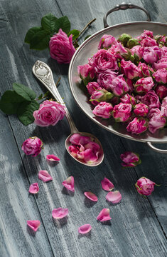 Vintage plate and spoon with tea rose buds
