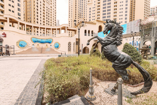 25 February 2021, Dubai, UAE: Horse sculpture and decorated staircase in the JBR residential quarter in Dubai is a popular tourist attraction