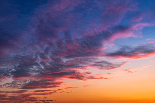 Colorful and vibrant cloudscape view of majestic sky at sunset or sunrise. Dramatic and idyllic background
