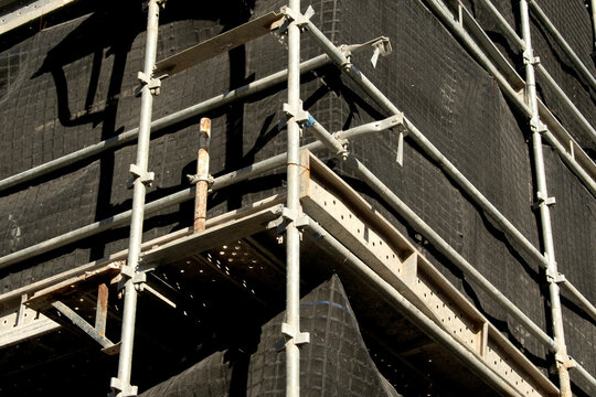 Construction progress scaffolding and safety netting closeup on building site at 56-58 Beane St. Gosford, Australia. May 2, 2021.Part of a series.