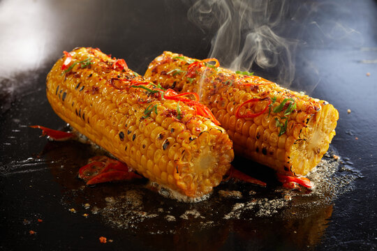Appetizing corn cooking on hot surface