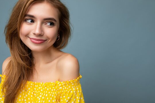 Closeup photo of young cute beautiful dark blonde woman with sincere emotions isolated on background wall with copy space wearing stylish summer yellow dress. Positive concept