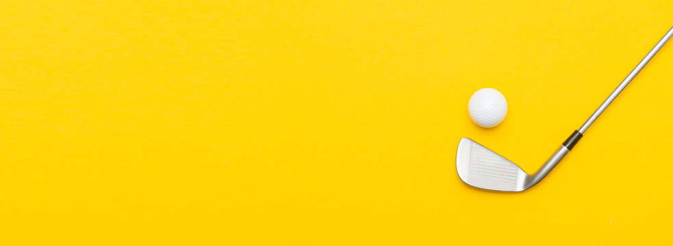 White golf ball and stick on yellow background. Horizontal sport poster, greeting cards, headers, website