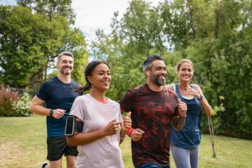 Mature people jogging in park