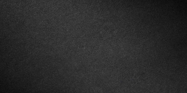 Paper black texture background.Paper surface made from thin wood pulp and can be recycled.