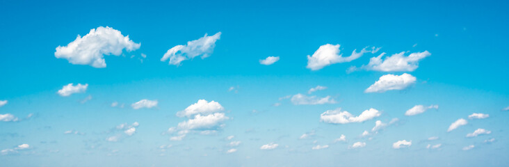 Fototapeta Panorama sky and clouds. White cumulus clouds on clear blue sky background closeup, overcast skies backdrop, fluffy cloud texture, beautiful sunny cloudscape heaven obraz