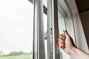 Fototapeta Hand opens white plastic window. obraz