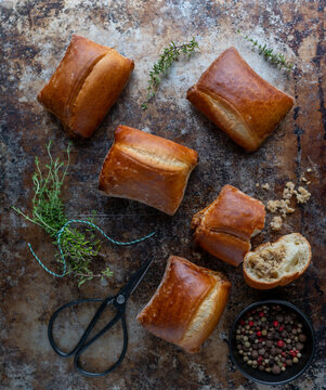 Baked meat buns from the oven on dark rusty background. View from the top.
