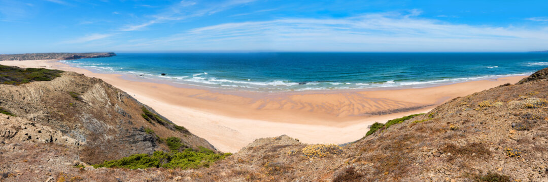 wide sandy beach Praia do Bordeira, blue atlantic ocean portugal