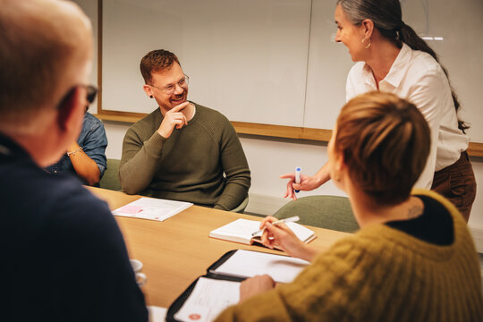 Business team smiling during a meeting in office