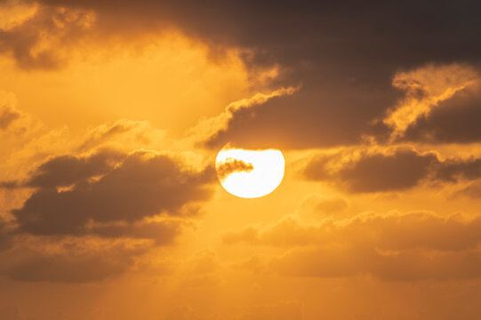 Rising sun on orange sky