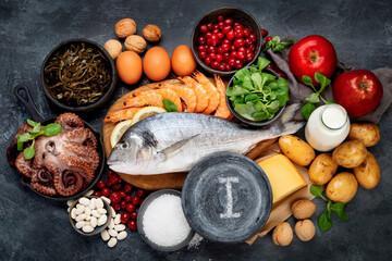 Fototapeta Food high in iodine on dark gray background. Healthy eating concept. obraz