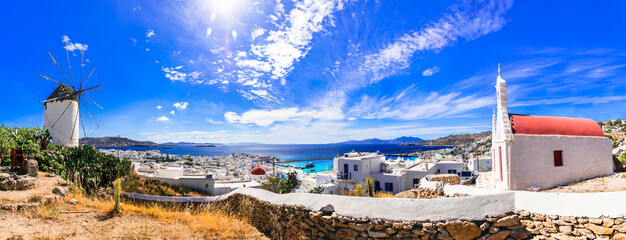 Traditional Greece. Cyclades, beautiful Mykonos island. Panoramic view of old town with windmill . Greek summer holidays