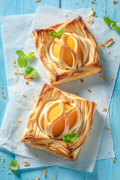 Delicious puff pastry baked with peaches. Unique yummy cake.