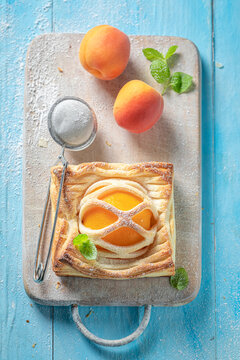 Homemade puff pastry with peaches and mint. French juicy dessert.