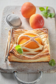 Homemade puff pastry baked with peaches. Unique yummy cake.