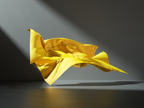 3d render. Abstract fashion background with yellow drapery falling on the floor inside the dark room illuminated with light. Silk textile is blown away by the wind