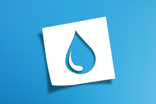 Note paper with water drop on blue background