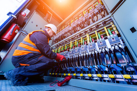 Checking the operating voltage levels of the solar panel switchgear compartment