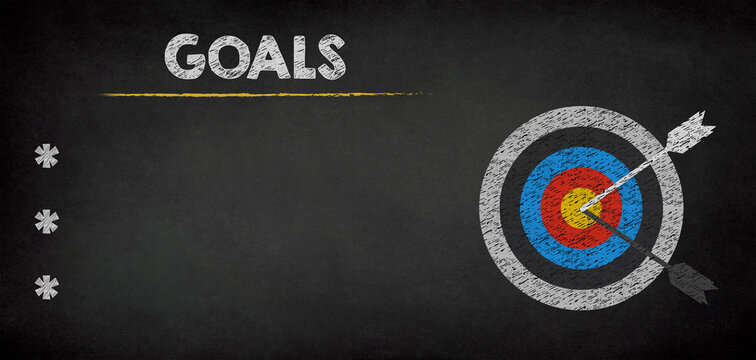 Goals and Target with arrow on chalkboard background