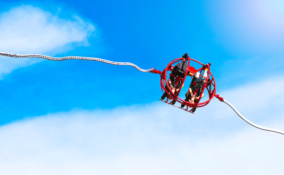 Extreme slingshot ride attraction in the city park