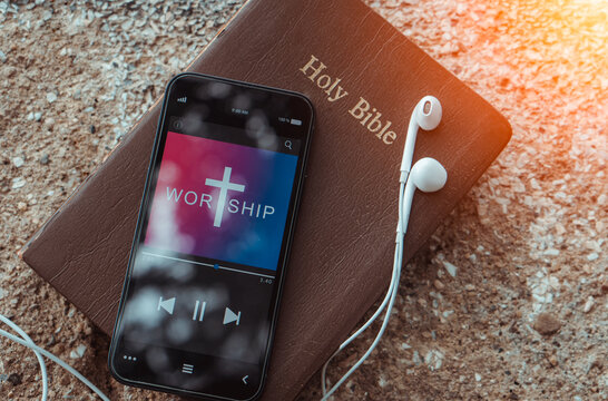 bible with phone and headphones,Concept listen worship song.