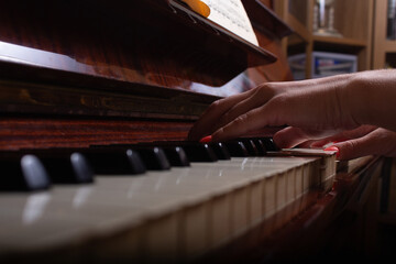 Girl and piano at home. Selective focus.