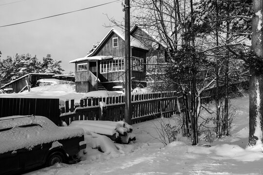 Rural typical house, in winter in the Republic of Karelia, Russia. Black and white photo.