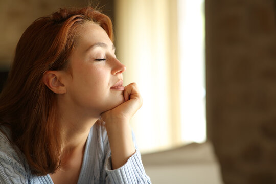 Relaxed woman resting with closed eyes at home