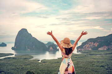 Freedom traveler woman relaxing with raised arms on the top of mountain at Thailand, Enjoy travel...