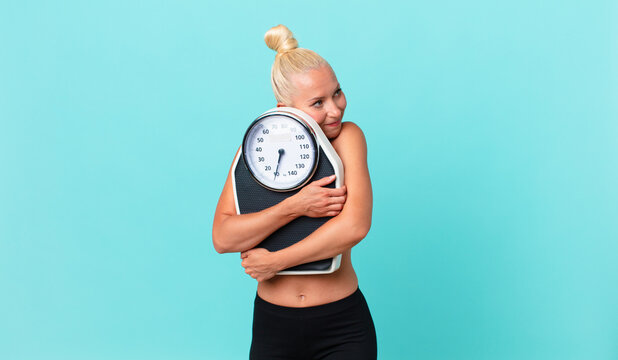 pretty adult woman with a weight scale