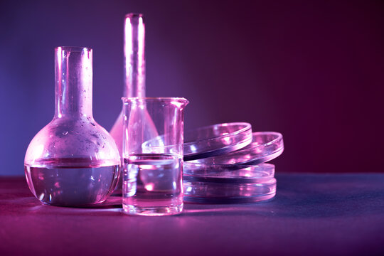Test tubes flasks and petri dishes, laboratory glassware. Medicine and biological or chemical research,