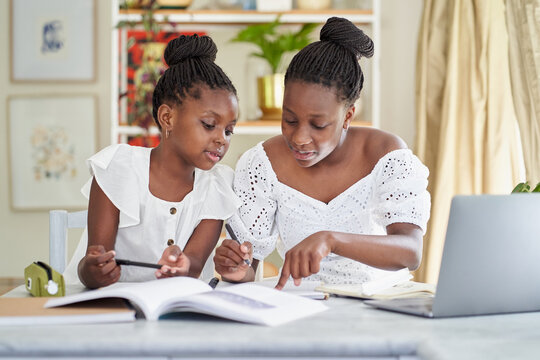 Sisters learning at home