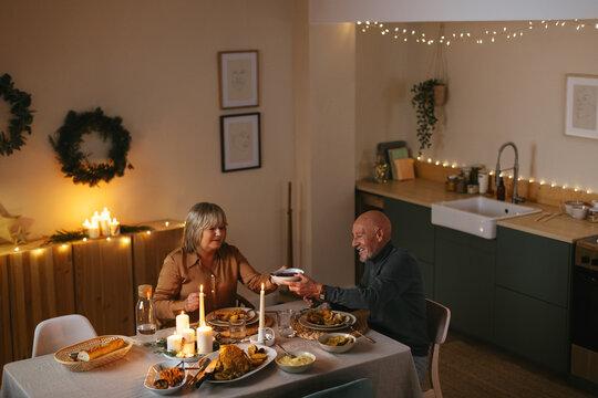 Senior couple enjoying traditional Christmas dinner at home
