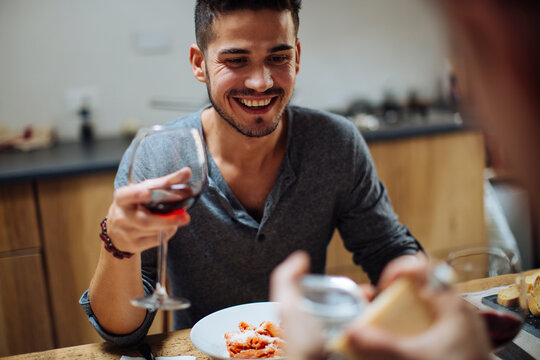 Happy man enjoying wine during romantic date