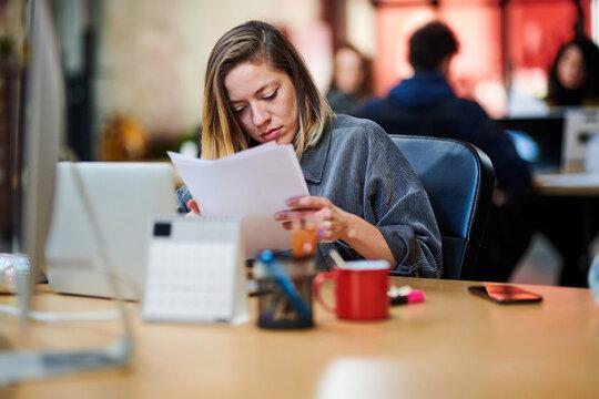 Employee reading document carefully.