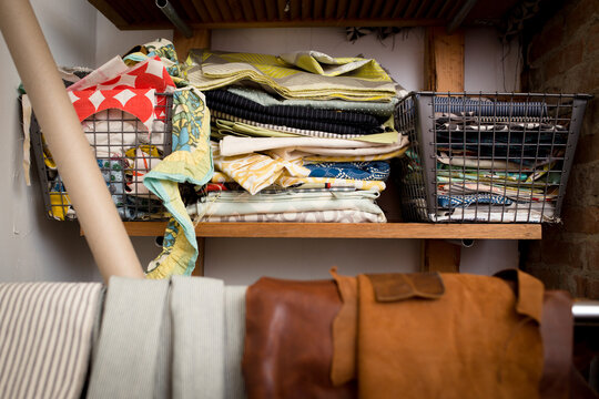 Studio shelf with fabric and leather swatches